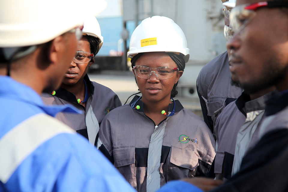 Workers at a power plant in Tanzania that has benefited from UK investment. Picture: CDC