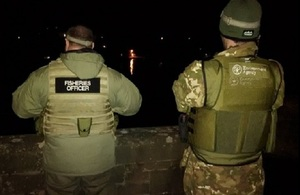 Image shows fisheries officers on patrol