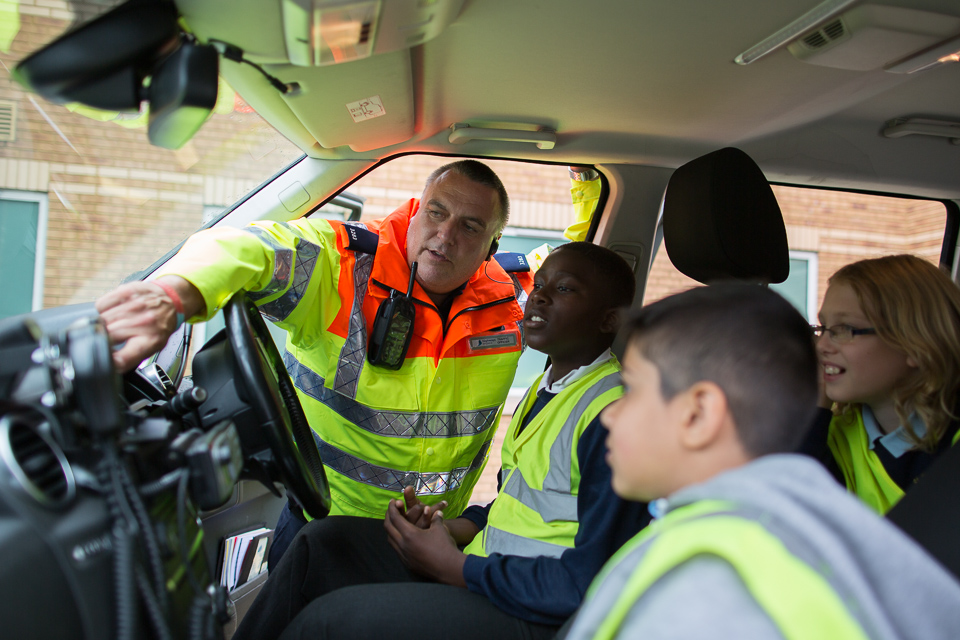 image of Traffic Officer showing pupils around a Highways England patrol vehicle