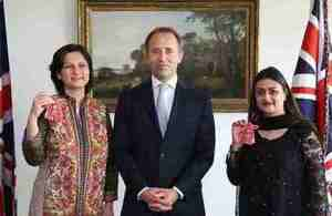 Nishat Riaz MBE and Shazia Khawar MBE, with the British High Commissioner, Mr Thomas Drew CMG, after receiving their honorary British awards for their exceptional services in the field of education and cultural relations