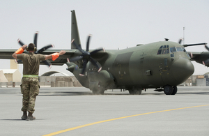 Ground engineers seeing off an RAF C-130J from the Tactical Air Transport flightline at 904 Expeditionary Air Wing, Kandahar Air field, Afghanistan.
