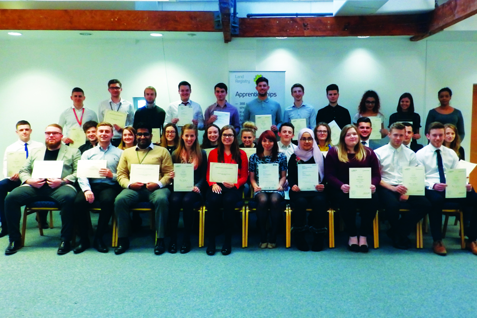 Picture of a group of apprentices holding the certificate for completing apprenticeship