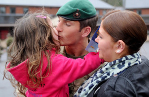 A Royal Marine kisses his daughter on his return to the UK from Afghanistan [Picture: Leading Airman (Photographer) Caroline Davies, Crown Copyright/MOD 2013]