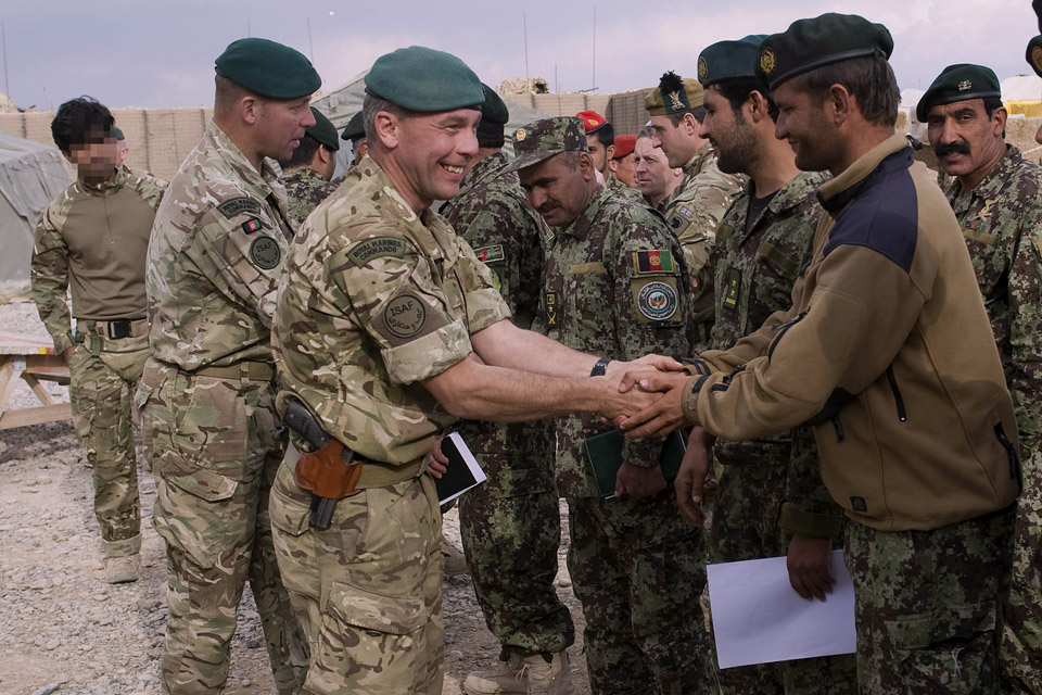 Royal Marines with members of the Afghan National Army