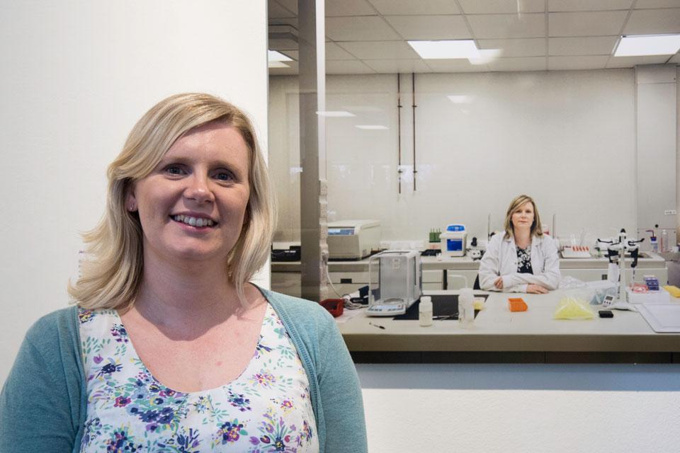 Entrepreneur Jenna Bowen, founder of Cotton Mouton Diagnostics, in front of her photograph.
