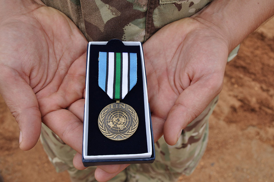The UNMISS medal which has been presented to troops from Op TRENTON 2 in Juba, South Sudan. Crown copyright.