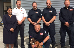 Priti Patel with members of the UK's International Search and Rescue (ISAR) team at Essex Fire and Rescue Service in Colchester.