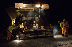 Picture of road workers performing road maintenance.