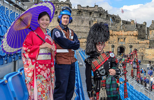 Leading Private Michiko Matsunaga (Japanese Ground Defence Force), Piper Michael Grant (1SCOTS) and Petty Officer Air Engineering Technician Mark Thompson (815 Naval Air Squadron). Crown Copyright.