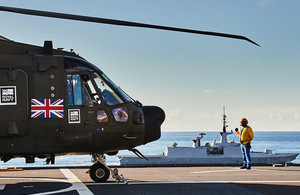 Merlin Mk3A helicopter of 845 Naval Air Squadron (NAS) working from the flight deck onboard FS Mistral in the Far East. Crown copyright.