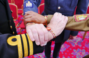 Personnel from each service with rakhis tied around their wrists.