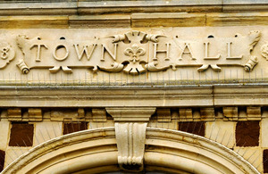 town hall sign on building