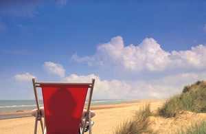 Deck chair on beach.