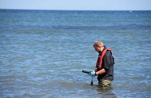 EA officer taking bathing water samples