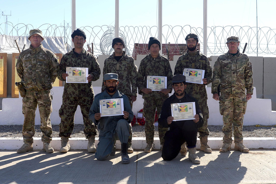 Newly-qualified Afghan explosives experts with their certificates and mentors