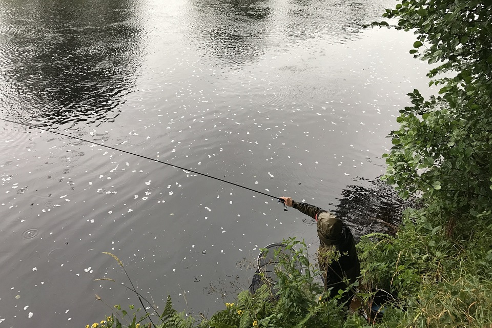 Image shows an angler taking part in the survey