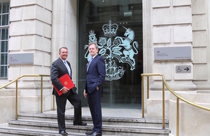 Secretary of State Dr Liam Fox welcomes chief trade negotiation adviser Crawford Falconer outside the Department for International Trade