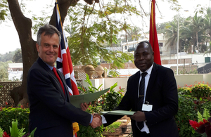 Ambassador John Dennis with Pascoal Baptistiny Head of Mbakita (Cubango's beneficiary mission for inclusion, technology and environment)