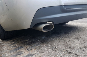 Car exhaust pipe.