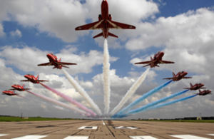 Pictured are The Red Arrows performing a low level flypast over 04 threshold at RAF Scampton.