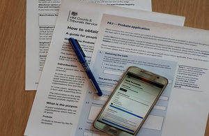 probate forms on table with mobile phone