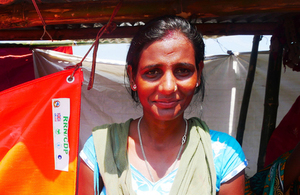A women outside her temporary shelter provided by UK aid in Sunsari district Nepal