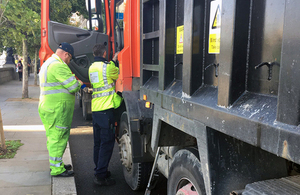 Environment Agency and DVSA staff check the details of a waste carrier