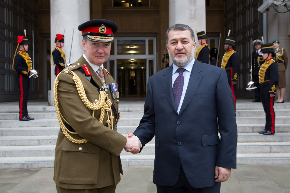 Afghan Defence Minister Bismillah Mohammadi (right) is greeted by General Sir Nicholas Houghton