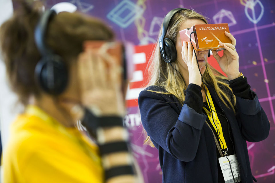 Two women wear AR headsets at Innovate 2016