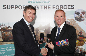 Philip Dunne presents Dave Burgess of the DSG with his Afghanistan campaign medals [Picture: Corporal Anthony Stinson RAF, Crown copyright]