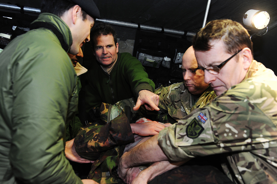 Troops from 144 Parachute Medical Squadron dealing with a simulated casualty