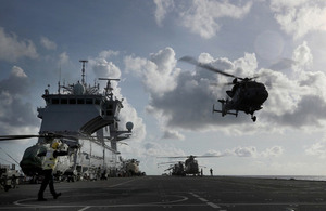 A Wildcat and Merlin Mk 3 Helicopters from 845 and 847 Naval Air Squadron, of the Commando Helicopter Force (CHF) conduct deck landing and winching practice.