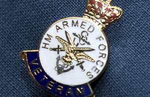 A veteran's badge being proudly worn on a lapel. Crown copyright.