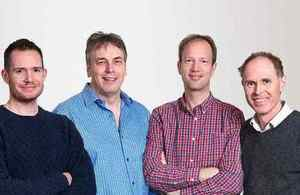 Genomics four-man management team in casual gear.