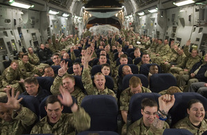 Soldiers from the 1st Battalion Scots Guards on board an RAF C-17 aircraft heading home from Afghanistan [Picture: Corporal Jamie Peters, Crown copyright]