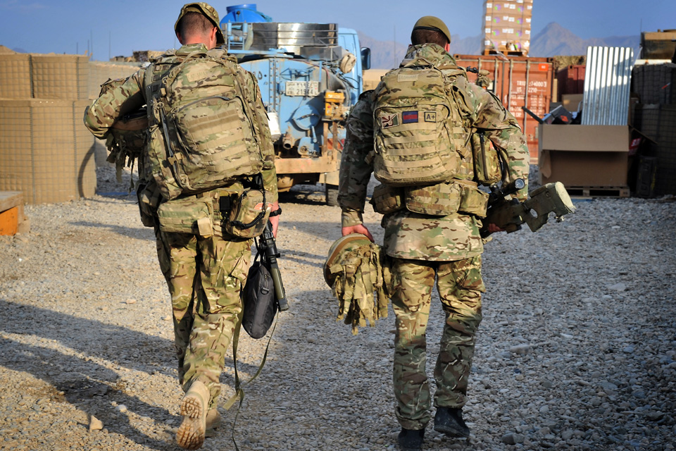 Soldiers of the 1st Battalion Scots Guards leaving Forward Operating Base Ouellette