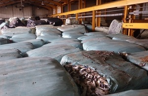 Image shows baled waste inside a warehouse