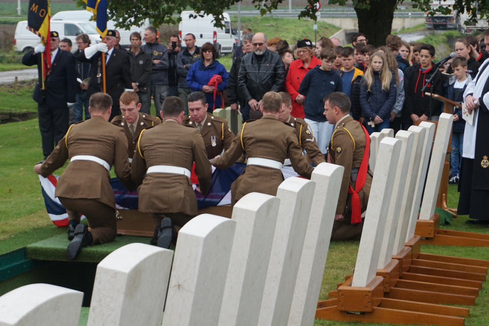 A bearer party prepare coffin to be lowered into the ground - Crown Copyright, All Rights Reserved