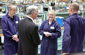 Secretary of State discussing DECA avionic repair capabilities with Dave Blenkley (pictured left), Dan Stinton (pictured right) and one of our recently qualified technicians from the DECA apprentice scheme, Chloe Lloyd.