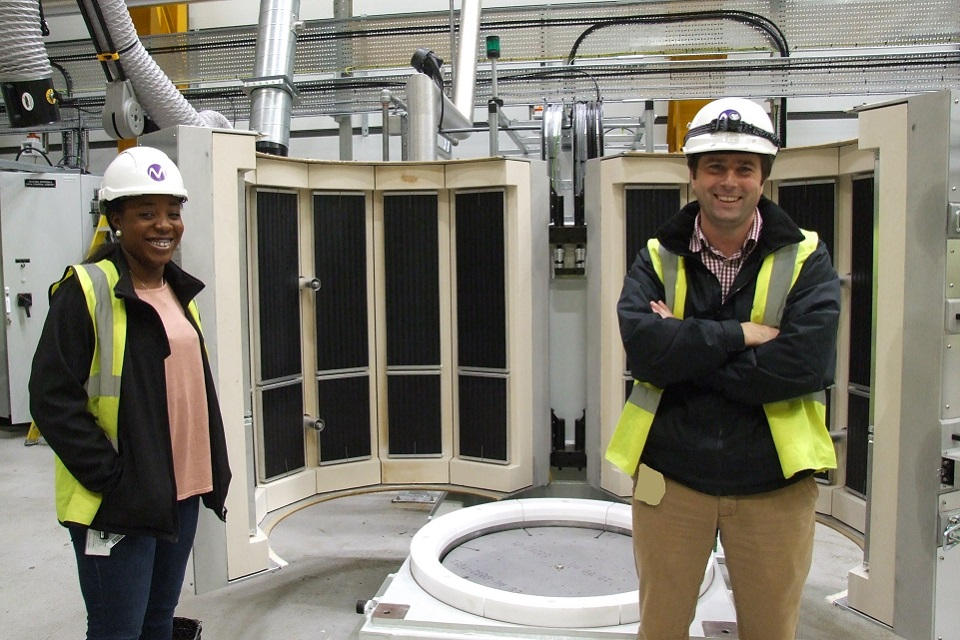 Rob Goodwill, Magnox Ltd Senior Project Manager, and Tomi Ashiru-Balogun, Magnox Ltd Senior Project Engineer in front  Advanced Vacuum Drying System (AVDS) at Dungeness A nuclear site