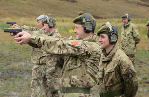 General Bob Bruce, with army reservists from 6 SCOTS, hone their military skills on the new range complex. Crown copyright. All rights reserved.