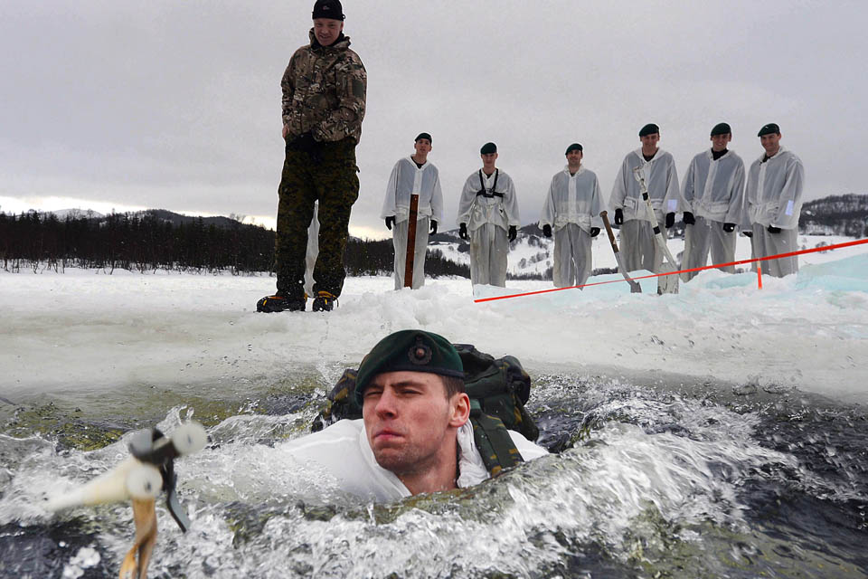Royal Marines conducting ice-breaking drills [Picture: Petty Officer (Photographer) Sean Clee]