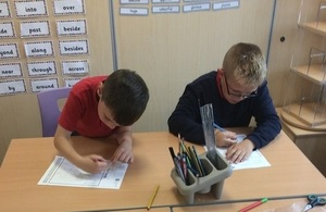 Image shows pupils working on their flood designs