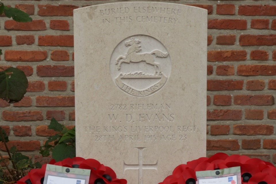 Newly placed gravestone bearing the name of Rifleman Evans. Crown Copyright. All Rights Reserved.