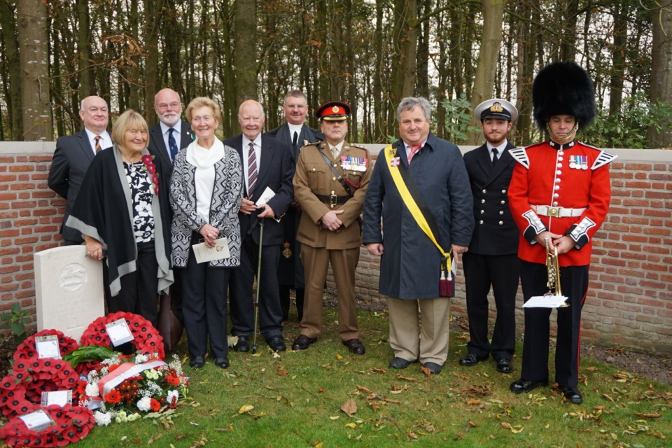 Standing by the graveside of Rifleman Evans his family; Regimental representatives and Deputy Mayor of Ypres; Sub lt Fred Warren Smith; and Max Harris, trumpeter. Crown Copyright. All Rights Reserved.