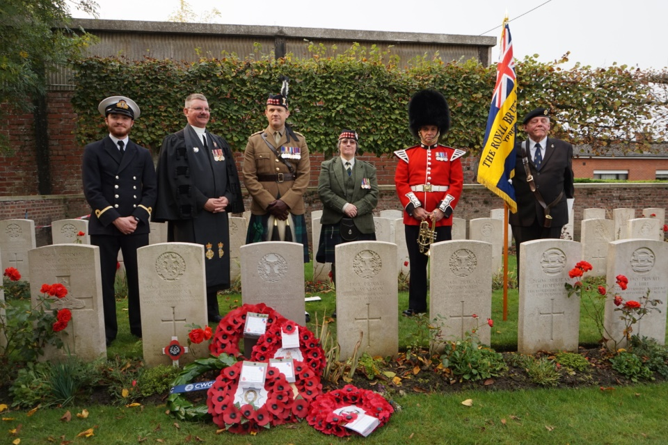 Standing by the graveside of Private Anderson Regimental representatives and a Royal British Legion standard bearer. Crown Copyright. All Rights Reserved.