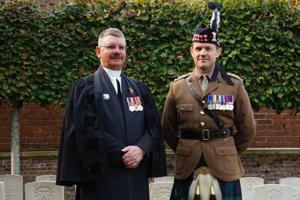 Reverend Paul van Sittert CF and Captain Gary Main both 4 Scots Regiment at the graveside of Private Anderson. Crown Copyright. All Rights Reserved.