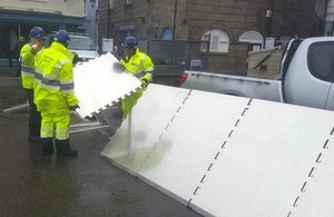Temporary flood defences being put in place