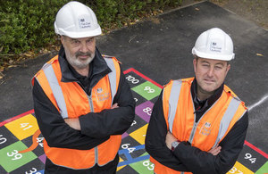 Alan Hines and Mick Owens from the Coal Authority's Public Safety and Subsidence Team oversee the repairs to the playground