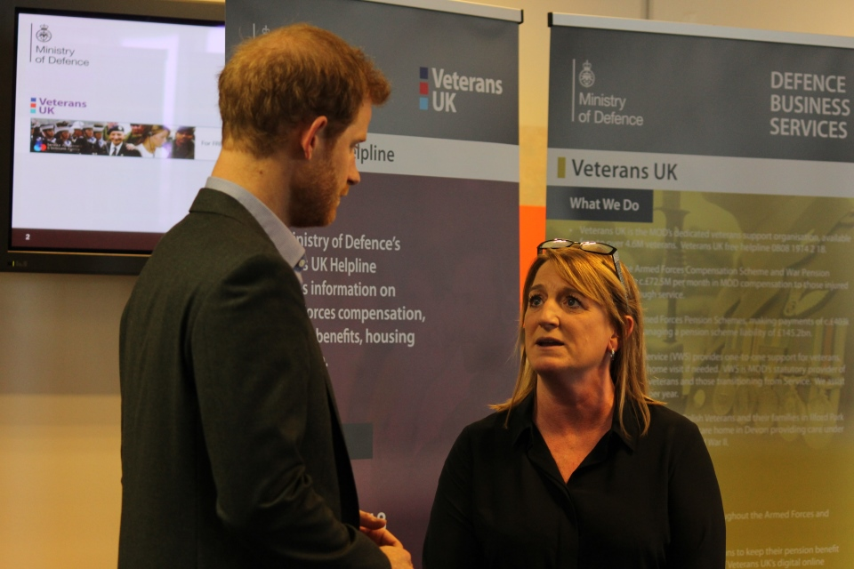 Christine Bulpitt explains the support provided by the Veterans UK Helpline team to Prince Harry, Crown Copyright, All Rights Reserved
